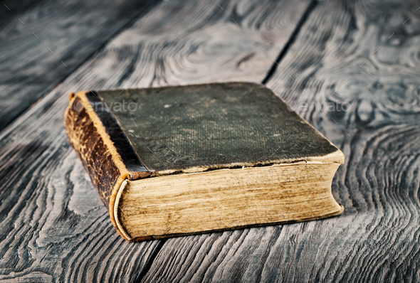 Ancient closed book with green cover - Stock Photo - Images