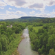Aerial of a River next to Small Town - VideoHive Item for Sale