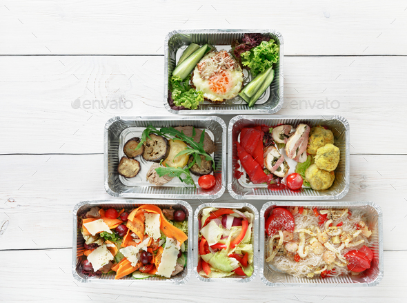 Healthy food take away in boxes, top view at wood - Stock Photo - Images