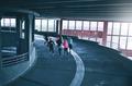 Runners inside parking building