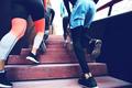 Cropped shot of runners in sportswear