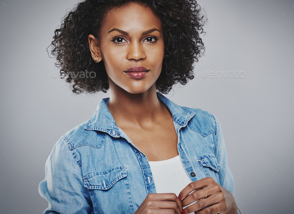 Serene woman with blue jean shirt and white top - Stock Photo - Images