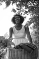 pretty young african american woman riding a bike in forest - PhotoDune Item for Sale