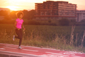 a young African American woman jogging outdoors - PhotoDune Item for Sale
