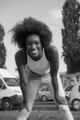 Portrait of sporty young african american woman running outdoors - PhotoDune Item for Sale