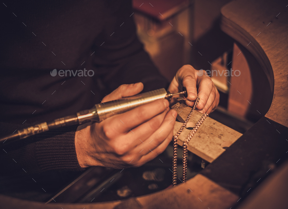 Jeweler at work in jewelery workshop - Stock Photo - Images