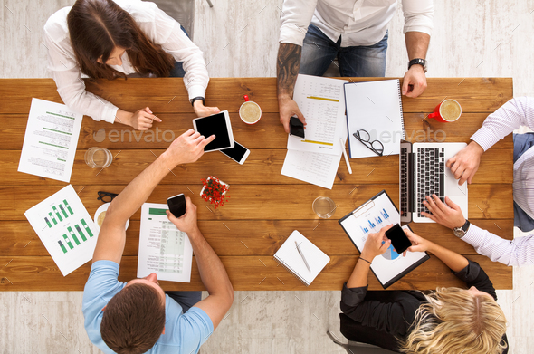 Group of busy business people working in office, top view - Stock Photo - Images
