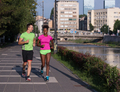 young smiling multiethnic couple jogging in the city - PhotoDune Item for Sale