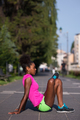 sporty young african american woman stretching outdoors - PhotoDune Item for Sale
