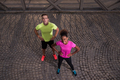 portrait of a young multiethnic couple jogging in the city - PhotoDune Item for Sale