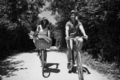 Young multiethnic couple having a bike ride in nature - PhotoDune Item for Sale