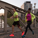 young multiethnic couple jogging in the city - PhotoDune Item for Sale