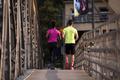 multiethnic couple jogging in the city - PhotoDune Item for Sale