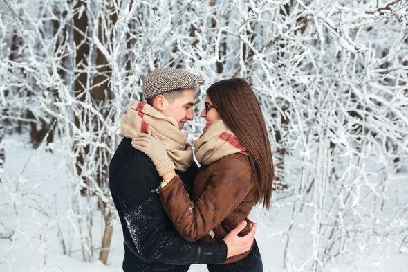 Happy couple in snow park - Stock Photo - Images
