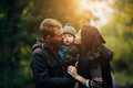 young family and newborn son in autumn park - PhotoDune Item for Sale
