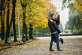 attractive happy couple walking in autumn park - PhotoDune Item for Sale