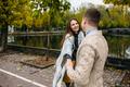 smiling couple in autumn park - PhotoDune Item for Sale