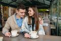 Couple sitting at sidewalk cafe - PhotoDune Item for Sale