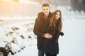 couple posing in a snowy park - PhotoDune Item for Sale