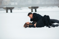 Girl and guy lie on snow - PhotoDune Item for Sale