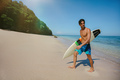 Male surfer holding surf board walking out of the sea - PhotoDune Item for Sale
