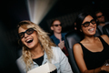 Female friends watching 3d movie and laughing - PhotoDune Item for Sale