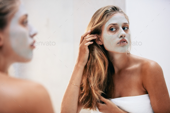 Female with facial cosmetic mask - Stock Photo - Images