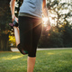 Fitness woman stretching legs in park - PhotoDune Item for Sale
