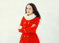 Fashion beautiful young woman wearing a red jacket in winter day