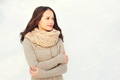 Beautiful young woman wearing a knitted sweater and scarf in win - PhotoDune Item for Sale