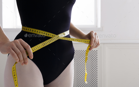 Beautiful ballerine torso with measuring tape, slim waist after diet