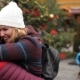 Romantic Dating Couple on the Christmas Fair, Man Is Rotating His Hugged Girlfriend Around, Xmas - VideoHive Item for Sale