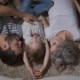 Happy Family Are Lying on the Carpet Together, Hugging and Kissing Each Other. Father and Mother Are - VideoHive Item for Sale