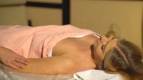 Attractive Blonde Woman Doing Hand Massage In A Spa Center Stock Footage