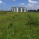 Grain Silos at the Green Grass Aerial - VideoHive Item for Sale