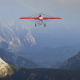 Little Red Airplane Flying Over Mountains - VideoHive Item for Sale