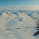 Winter in the Mountains. Flying Over the Road in Winter. - VideoHive Item for Sale