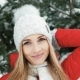 Blonde Woman Taking Part in Winter Photo Shoot Near Fir Tree - VideoHive Item for Sale