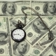 Time Is Money - a Pocket Watch on a Background of One-hundred Dollar Bills - VideoHive Item for Sale