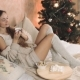 Woman in Warm Sweater on the Bed with Cup of Coffee in Hands, Christmas Tree New Year - VideoHive Item for Sale