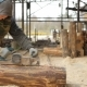 Construction Worker Planing a Piece of Wood for a Building Project. Construction Grinds Electric - VideoHive Item for Sale