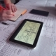 Woman Architect Uses Tablet Examining Blueprints - VideoHive Item for Sale