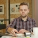 Man Pays Customer Purchase Cards in the Office Using the Terminal. He Holds and Pulls Out a Card - VideoHive Item for Sale