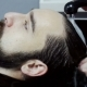 Barber Washing Male Hair in a Barbershop - VideoHive Item for Sale
