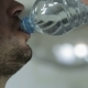 . Face of the Tired Young Man Drinking Water. - VideoHive Item for Sale
