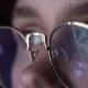 The Machine Code Is Reflected in the Hacker's Glasses - VideoHive Item for Sale