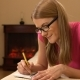 Beautiful Attractive Young Woman Writing in Notebook. Making a List, Thinking and Smiling - VideoHive Item for Sale