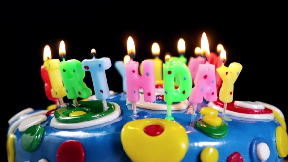 Happy Birthday Candles On A Cake Stock Footage