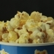 Salty Popcorn Slowly Rotates on Black Background - VideoHive Item for Sale
