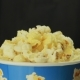 Hand Grabbing Popcorn on Black Background - VideoHive Item for Sale